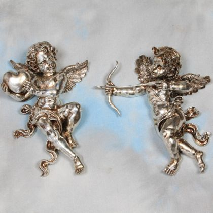 pair of wall hanging silver cupids