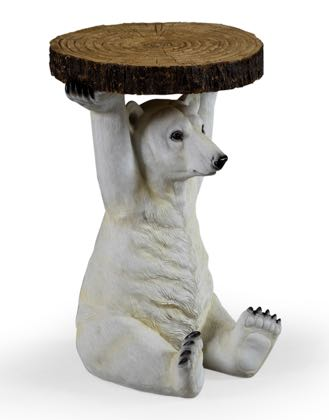 Meet Peter our polar bear side table who is holding a slice of tree trunk above his head that is the table top. He measures 52 x 36 x 36cm and made of resin hand painted and finished