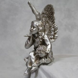 stunning silver sitting angel is blowing you a kiss and measures 20 x 40 x 17cm. She sits securely on any flat shelf edge