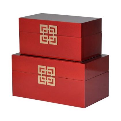 This pair of laquered red storage boxes are beautifully styled. With a central lovely gold oriental motif. Perfect in any room. Great colour and value. The large one measures H17 x W34.5 x D20cm and the small one is still useful atH14.5 x W29 x D16.5 cm.