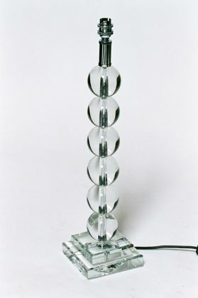 tall crystal ball lamp has 6 glass balls sat on a square base
