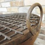 Cast iron fire pit handle detail and grill