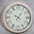 large cream multi dial clock has 6 mini dials for different time zones a superb glossy finish and easy to read black numerals on a white face