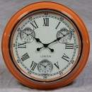 orange retro multi dial clock cream face black hands