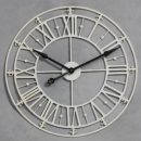 This medium sized cream skeleton clock has fabulous roman numerals and is hand finished with a crackle effect all over. The hands are black. Takes one AA battery and measures 76 x 76cm