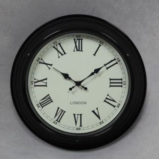 This 31cm black kitchen clock fits in any space. Very stylish, with a selection of colours to suit your decor. Roman numerals on a cream face. 31 x 31 x 9cm