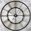large black gold skeleton clock is made of metal hand painted black edges with gold numerals 110cm x 110cm