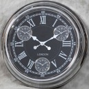 chrome black multi dial clock has black face silver hands and numerals and 3 mini dials for Sydney Paris and New York