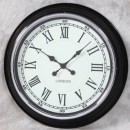 black retro clock with white face black numerals and hands and glossy finish