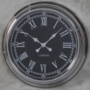 chrome retro clock with black face and silver numerals and hands