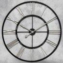 large black silver clock this clock is skeleton in style and hand finished and measures 110 x 110cm