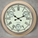 cream multi dial clock with white face and black hands and Roman numerals with 3 smaller dials for different time zones