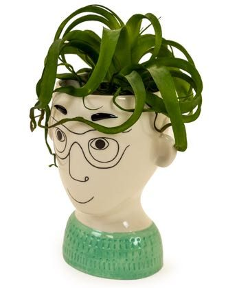 This doodle man face vase, with his stylish specs and an ever positive grin. Will brighten up any room. 30 x 23.5 x 18.2cm. Glossy cream ceramic