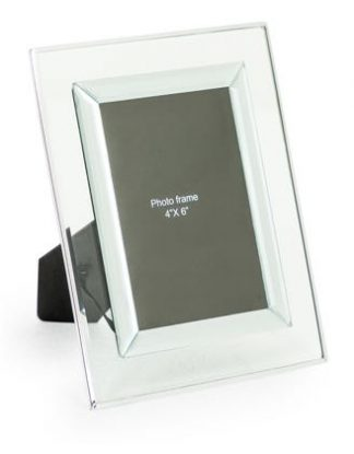 "This glass photo frame is the perfect accessory that will draw attention to your treasured memories. H22.5xW17.5xD0.8cm. Takes 4 x 6"" photos. Great gift!"