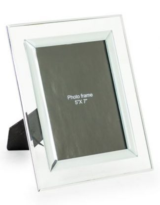 This glass photo frame is the perfect accessory that will draw attention to your treasured memories. H25 x W20 x D0.8cm Takes 5 x 7 photos. Great gift!