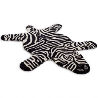 Add a monochromatic, exotic style with this superb hand tufted small zebra rug. With a dense luxurious pile this rug feels and looks superb. 60 x 90cm