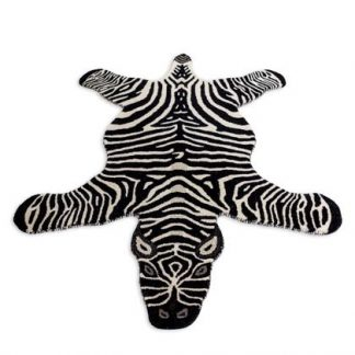 Add a monochromatic, exotic style with this superb hand tufted large zebra rug. With a dense luxurious pile this rug feels and looks superb. 120 x 180cm