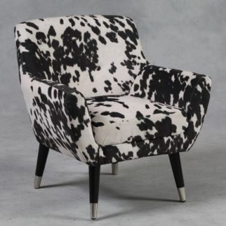 retro styled cream and black cowhide chair