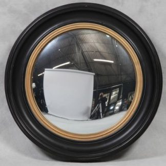 Damaged large black convex mirror is a huge round mirror that has a black and gold painted wooden frame and a convex mirror