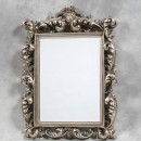 large silver rococo mirror is highly ornate painted a suer antique silver colour and measures120 x 88 x 14cm (75 x 55cm glass)