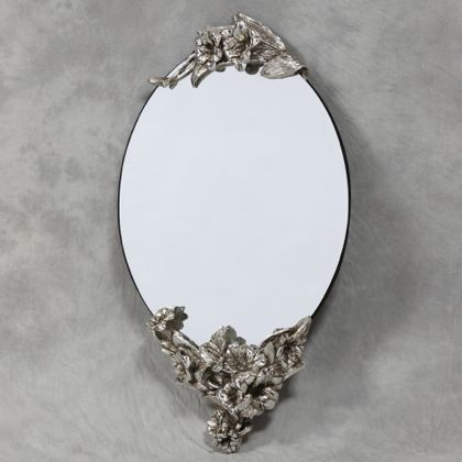 oval frameless lily mirror is a small wall mirror with bevelled edges silver cresting floral detail top and bottom that measures87 x 46 x 14cm (56 x 46cm glass)