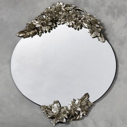 oval butterfly frameless mirror has metallic plated detailing top and bottom the mirror has bevelled edges
