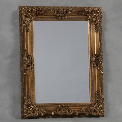 golde ornate regal mirror is a large rectangular wall mirror that is painted gold and measures 118 x 90 x 10cm