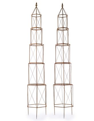 This garden obelisk pair are a super addition to any garden. Tall and elegant, made of rusty metal . Has spikes at foot to secure it. 226 x 42 x 37cm each