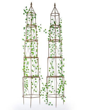 Look at this super stylish garden obelisk. Made of metal, a traditional rusty colour this tall support is practical and stylish. 226 x 37 x 42 cm . Value