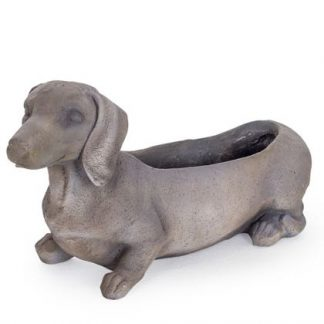 Our dachshund dog planter is a must have for your garden. Made of grey fibrous resin that is sturdy yet light. A feature piece! 31x 57 x 20cm.