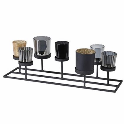 This multi candleholder has 7 seperate tealight holders set on a black metal framework that puts them at varying heights. Measures 46 x 18 x 15cm Great gift