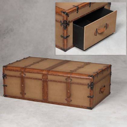 This steamer trunk coffee table is huge and is covered in canvas with leatherette detail. Measures H41 x W121 x D71cm . A real bonus to any room