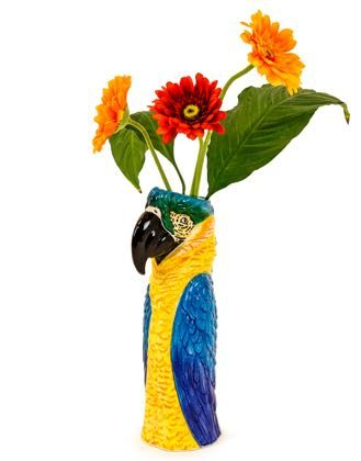 Our blue ceramic parrot head vase is sure to be noticed in any room within your home, and will certainly turn heads. Measures at H36 x W12 x D15cm.