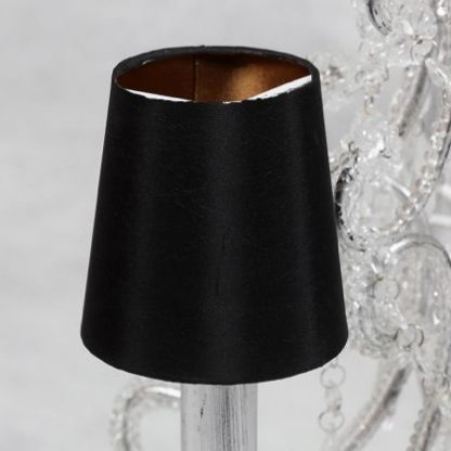 This black gold candle shade maybe small but has a huge impact on the lighting in your home. Perfect for use on candle bulbs found on wall sconces or chandeliers. Measures 10 x 10 x 10cm and great value for money. Black outer with gold inner.