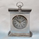 silver square table clock round face with handle on top made of polished aluminium