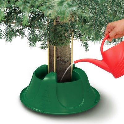 This swift tree stand holds christmas trees up to 7ft. The metal prongs screw into the green wide plastic base. Has a water resevoir to keep your tree well.